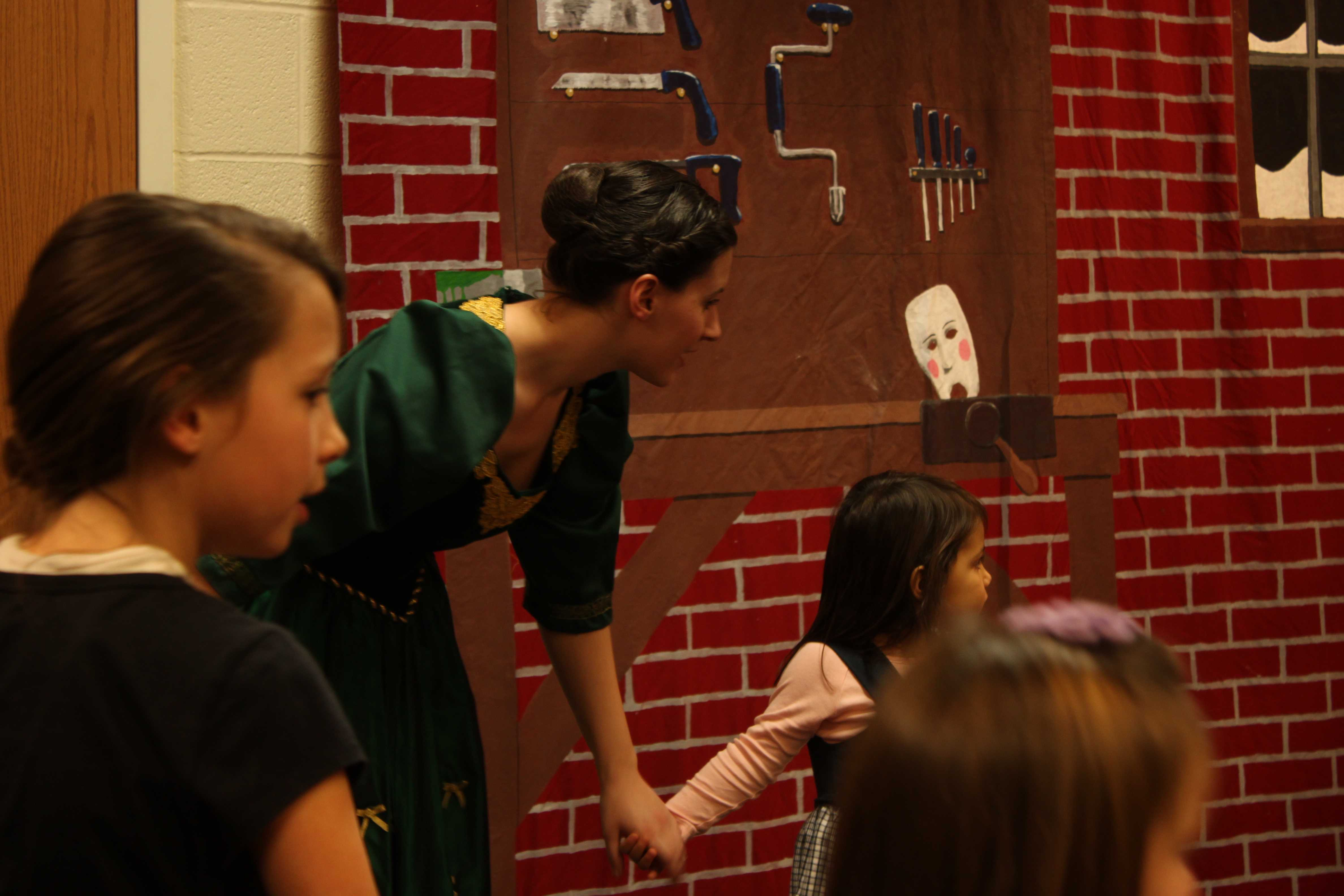 Senior Nolie Wagner interacts with children at a meet and greet at the Granville Public Library. PHOTO BY JULIA LERNER